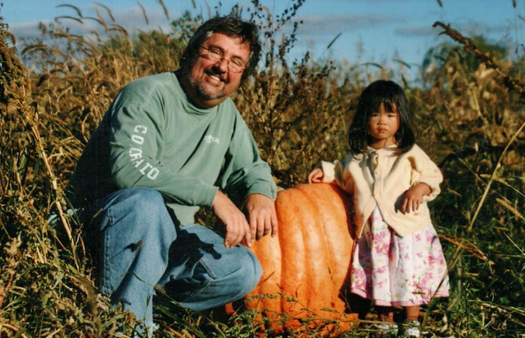 Olivia and paige with big pumpkin